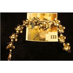 Sterling 5-petaled flower bracelet, 8  long, marked 925 ARTISTIC 12.5 g / 8 dwt