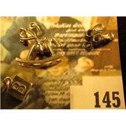 (3) sterling baby-related charms – AB building block, rocking horse, baby shoes, 7.7 g / 5.0 dwt