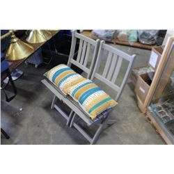 TWO PAINTED FOLDING CHAIRS WITH CUSHIONS