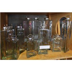 SHELF LOT OF TRIANGULAR GLASS STORAGE JARS