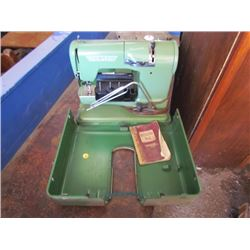 Sewing machine ELNA c/w case and book