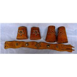 """Child's bronc belt and 2 pair cuffs, 26"""" belt"""