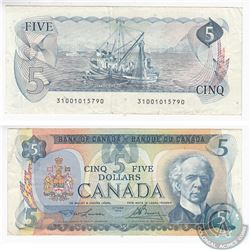 1979 Replacement $5.00 Note with Lawson-Bouey Signatures in Very Fine Condition.  The Note has a sma