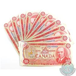 10 x 1975 $50.00 Notes Featuring the RCMP Musical Ride in Average Circulated Condition.  10 pcs.