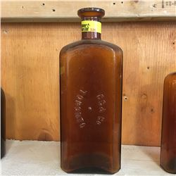 "Brown Embossed Bottle: ""CC&Co Toronto"""
