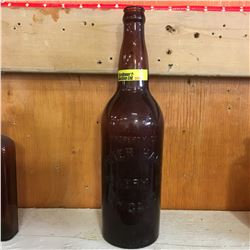 "Brown Embossed Bottle: ""Property of Peter Hand Brewery Co. Chicago"""