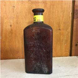 """Brown Embossed Bottle: """"Mary T. Goldman St. Paul, Min"""""""
