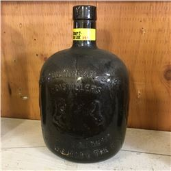 """Green Embossed Bottle: """"James Buchanan & Co. Ltd. Distillers by Appointment to his Majesty the King"""""""