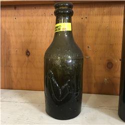"""Green Embossed Bottle: """"J. Pratt & Son Manchester No 4150 Trademark"""""""