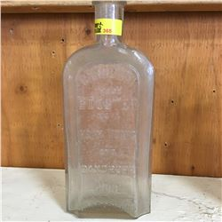 """Clear Embossed Bottle: """"Canadian Trade Booster Mark Hair Tonic and Dandruff Cure Windsor Ont"""""""