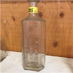 Clear Embossed Bottle:  N.H. Kilmer's Pharmacy Kingman, Kansas