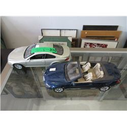 Two 1:18 Scale Model Cars