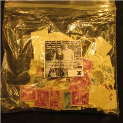 Bag of U.S. Stamps. Most are 4c, 5c, & 6c.