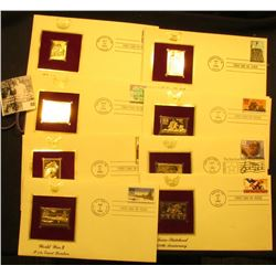 (8) First Day of Issue Cancelled covers with 22K Gold Replica Stamps.