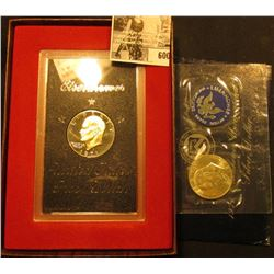 1971 S Proof & Uncirculated Silver Eisenhower Dollars. Both in original holders.