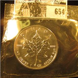 1991 Canada Five Dollar One Ounce .9999 Fine Silver Maple Leaf in mint sealed plastic.