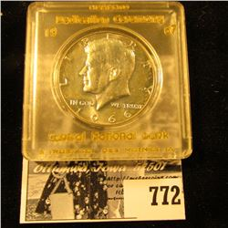 "1966 Brilliant Uncirculated Kennedy Half Dollar in a Snap-tight case labeled with gold lettering ""Me"