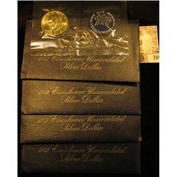 (4) 1972 S Silver Eisenhower Dollars in original blue packs of issue. All Gem BU.