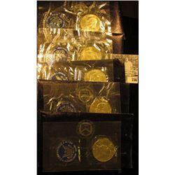 (5) 1971 S Silver Eisenhower Dollars in original blue packs of issue. All Gem BU.
