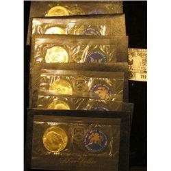(1) 1973 S & (5) 74 S Silver Eisenhower Dollars in original blue packs of issue. All Gem BU.