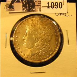 1090 . 1885 P U.S. Morgan Dollar, Uncirculated. Nice attractive gold toning.