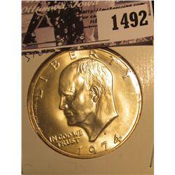 1492 . 1974 S Silver Gem BU Eisenhower Dollar, carded in 2 x 2 holder.