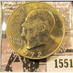 1551 . 1972 P Eisenhower Dollar, Gem BU with light gold toning.
