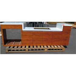 "Koa Veneer Cabinet w/ White Countertop w/Sink Cut-Out 9'8x26"". Staggered Height 38"" x 29"" x 38""H. Si"