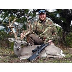Texas Whitetail and exotic hunt for two hunters ($4000 credit)