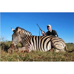 MOTSOMI SAFARIS 7-Day Hunt for 2 Hunters and 2 Non-Hunters for Impala, Wildebeest and Zebra