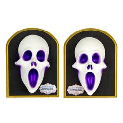 "Pair of ""Haunted Mansion"" Organ Ghost Plaques."