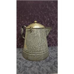 Granite-ware camp coffee pot, with old time coffee grounds
