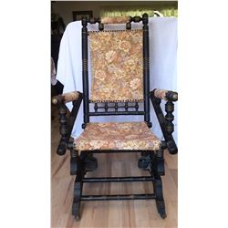 """Vintage wooden rocking chair with rollers on the front. 41"""" from floor to top of back, 22"""" wide and"""