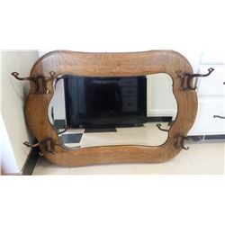 "Oak framed coat/hat rack with beveled mirror 33"" W x23 H"