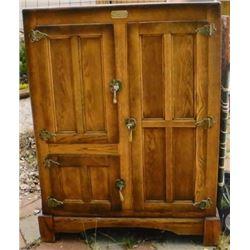 Large oak ice box, twin front doors and rare rear door
