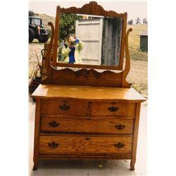 Fancy oak serpentine dresser , bev. mirror, 4 drawer