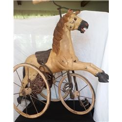 """Child's plaster horse tricycle (Victorian Velocipede) 21"""" l x 23"""" h, wood wheels, real horse hair ta"""