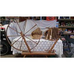 "Spinning wheel with basket of niddie noddies, shuttles and basket of twine. 72"" L x 60"" H x 6 ½"" W"