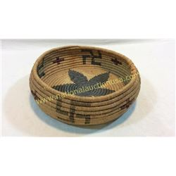 Early Woven Basket With Rolling Logs