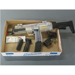 New Out of box Air Soft / comes with battery / clip / charger / manual