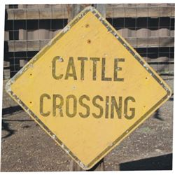 wooden cattle crossing sign