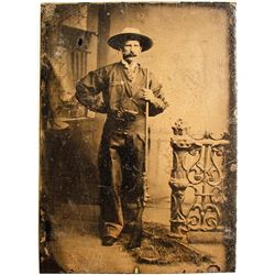 Tintype of a Cowboy and His Rifle