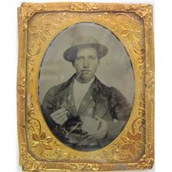 Tintype of Miner Holding Two Ingots