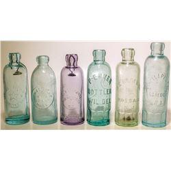 Five Hutch Soda Bottles