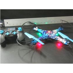 Drone has battery pack turns on / no charger as-is not tested unknown cond.
