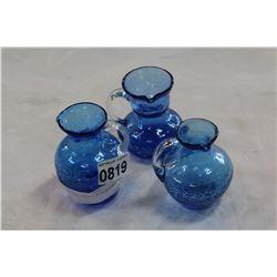 THREE BLUE ART GLASS MINIATURE PITCHERS
