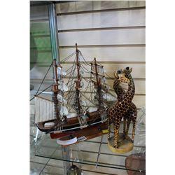MODEL SHIP AND GIRAFFE