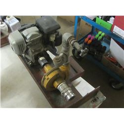 2 inch Honda water pump / has garden hose fitting to be used from dugout