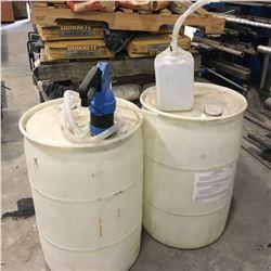 2 PLASTIC BARRELS WITH DIESEL EXHAUST FLUID