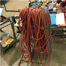 LOT OF ASSORTED EXTENSION CORDS AND STANDS